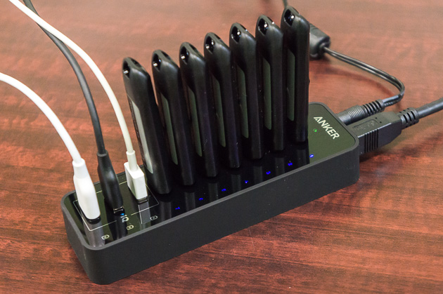 The Anker USB hub with many devices attached to it.