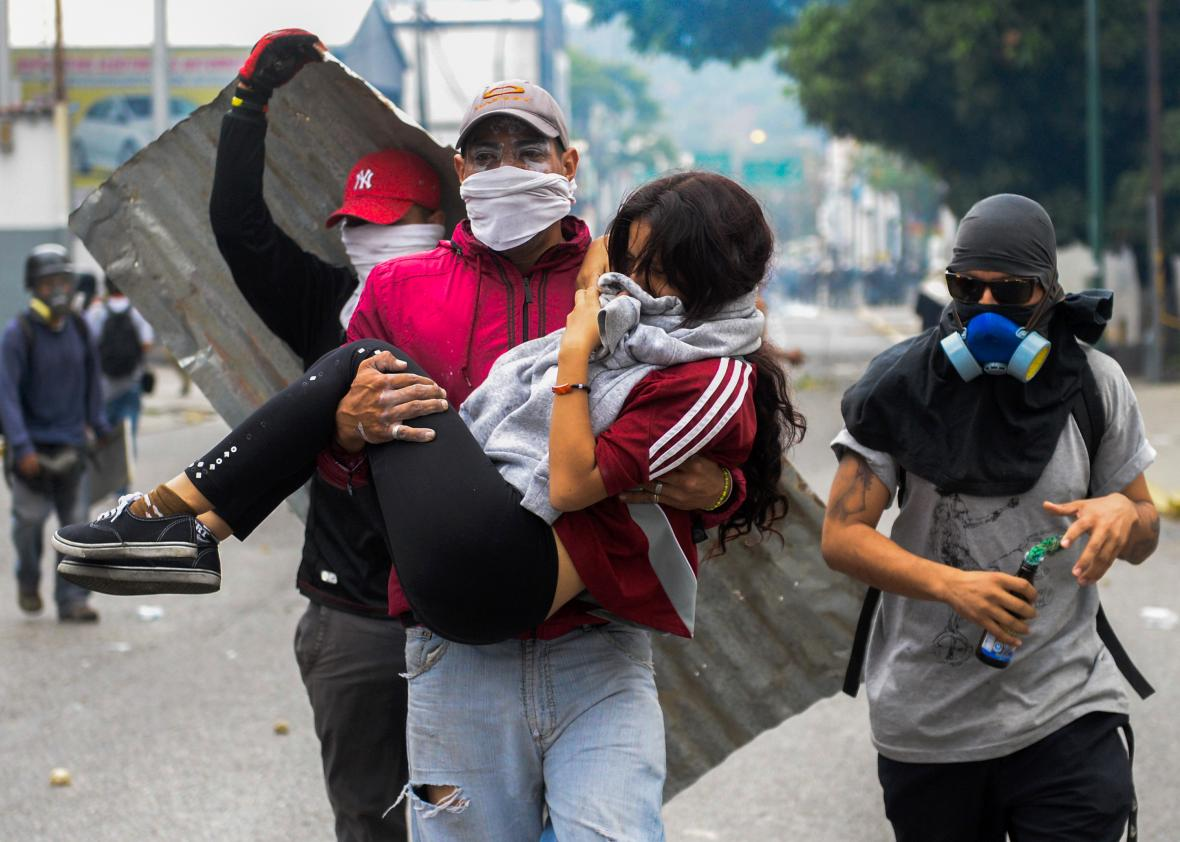 666985412-young-woman-who-was-overcome-by-tear-gas-shot-by-tiot