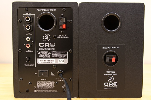 A photo of the inputs on the back side of two Mackie CR3 computer speakers.