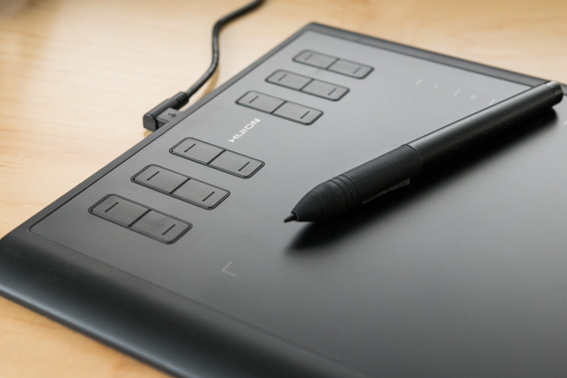 A closeup of the Huion 1060 Plus's shortcut keys. There are six rows of two keys on the left side of the tablet.