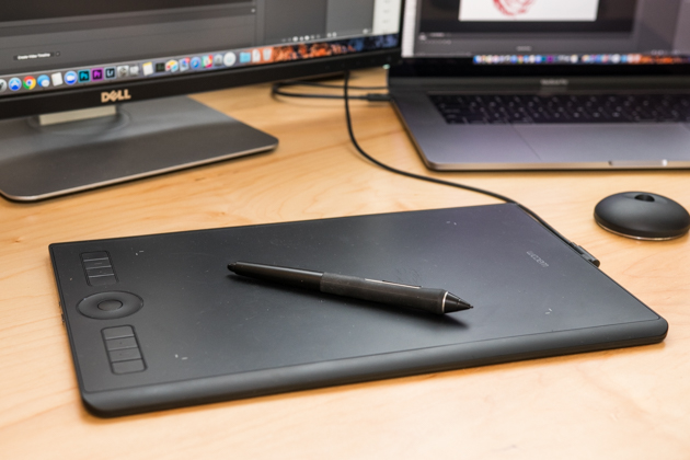 Our upgrade pick the Wacom Intuos Pro drawing tablet hooked up to a Dell computer.