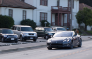 Tesla flips a switch to increase the range of some cars in Florid...